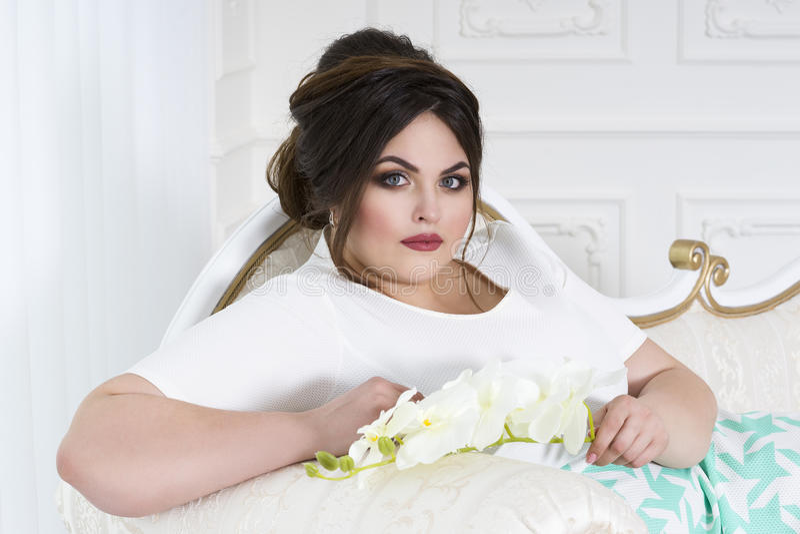 Plus size fashion model, fat woman on luxury interior, overweight female body stock photo