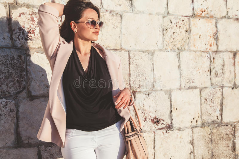 Plus size model wearing fashion clothes in city street stock photography