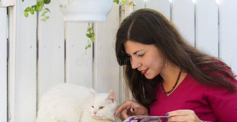 Plus Size smile woman cat french style happy. Plus Size woman with a cat outdoor. Beautiful girl looks fashion magazine royalty free stock image