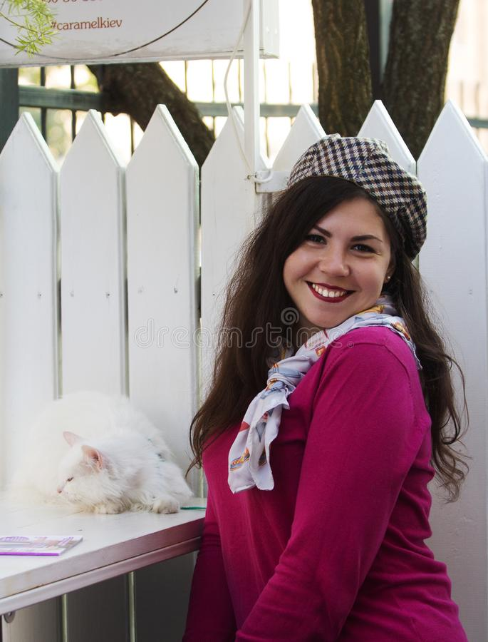 Plus Size smile woman cat french style happy. Plus Size woman with a cat outdoor. Beautiful plus size girl in an outdoor cafe in french style stock photos