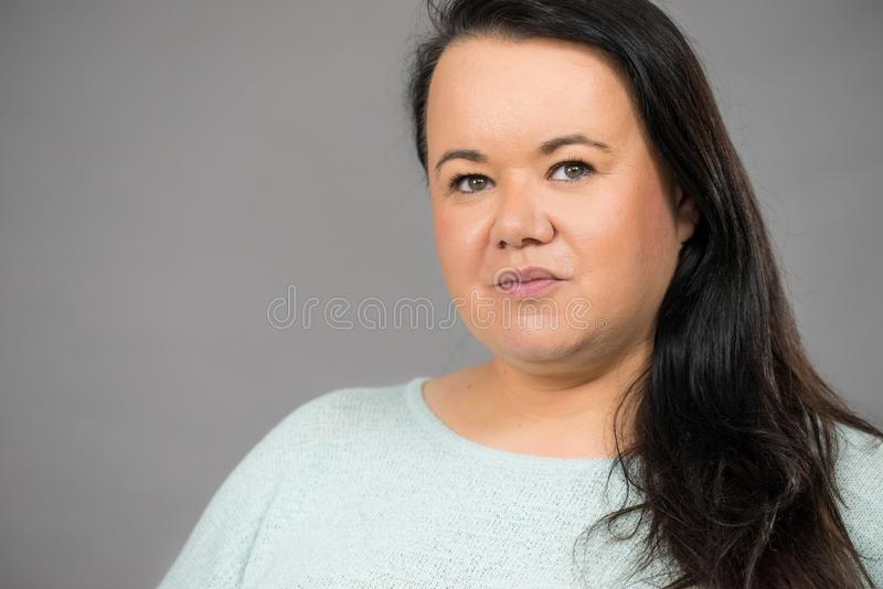 Plus size woman portrait. Adult plus size woman, mature famale round face, long dark hair stock images
