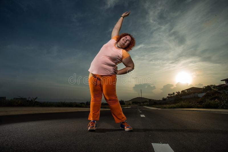 Beautiful young fat woman is runing stock photography