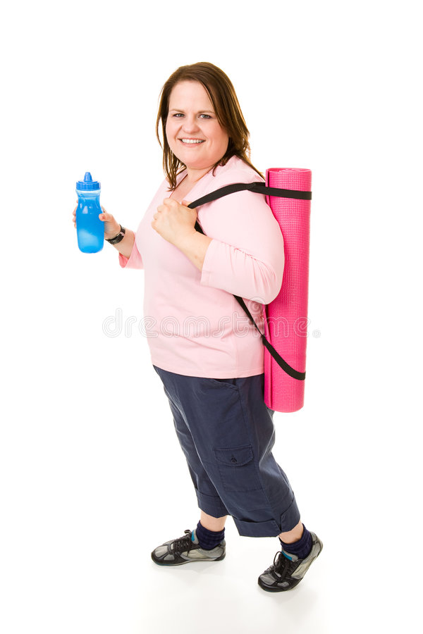 Plus Sized Fitness - Full Body. Pretty plus sized model on her way to the gym with yoga mat and water bottle. Full body isolated on white stock photos