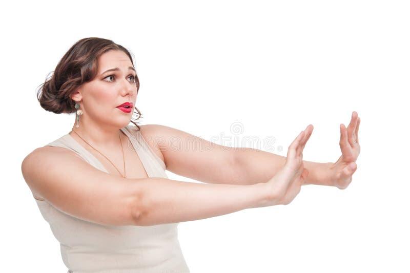 Plus wielkościowa kobieta robi odmówić gestykulować obraz royalty free