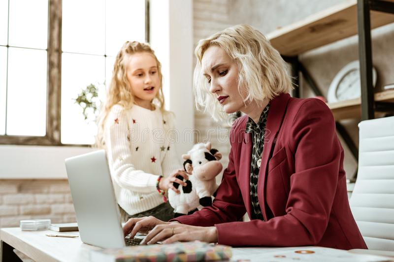 Irritated busy working woman working no matter what royalty free stock photography