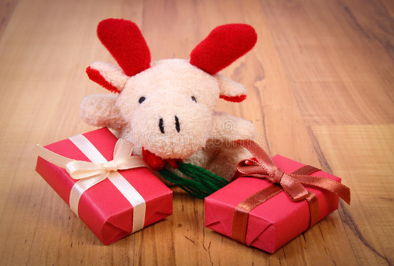 Plush reindeer with colorful gifts for Christmas or other celebration. Plush reindeer and wrapped colorful gifts for Christmas, birthday, valentines or other stock photo
