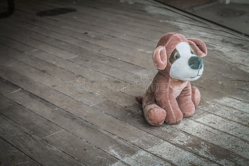 Plush Toy Dog Abandoned. Plush toy dog left behind in the window of an abandoned storefront in Texas town stock image