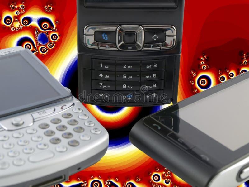 Plusieurs téléphones portables modernes avec psychédélique photographie stock libre de droits