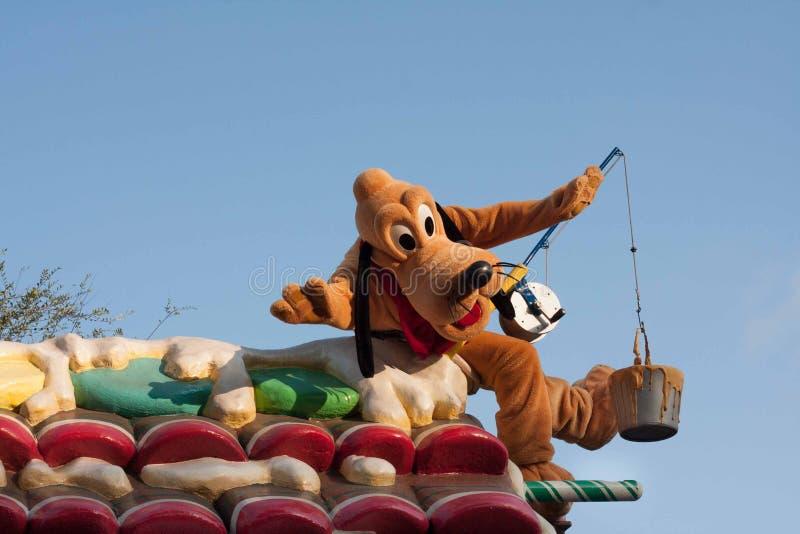 Pluto het Jong op vlotter in Disneyland Parade stock foto's