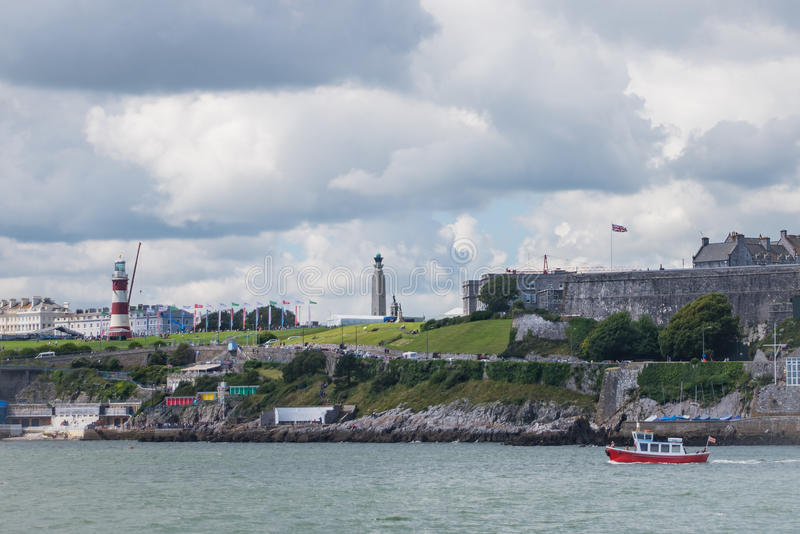 Plymouth Hoe. View of Plymouth Hoe and Smeaton`s tower from Mount Batten breakwater royalty free stock photos