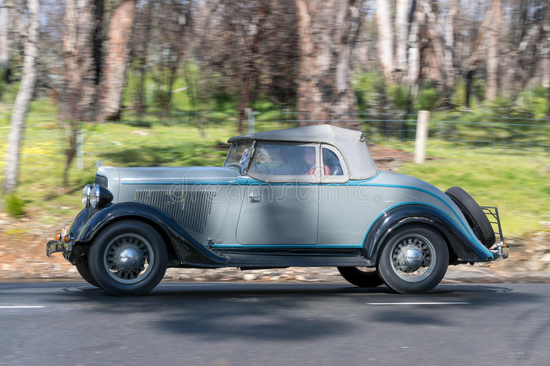 1934 Plymouth PF Roadster. Adelaide, Australia - September 25, 2016: Vintage 1934 Plymouth PF Roadster driving on country roads near the town of Birdwood, South royalty free stock image