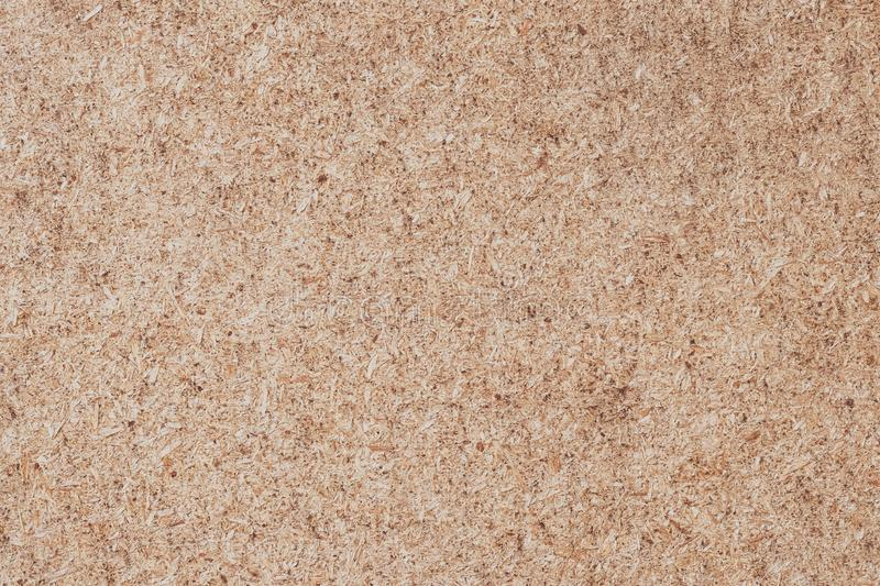 Plywood background. Cork texture, wood panel, chipboard. Desk surface. Natural color royalty free stock photos
