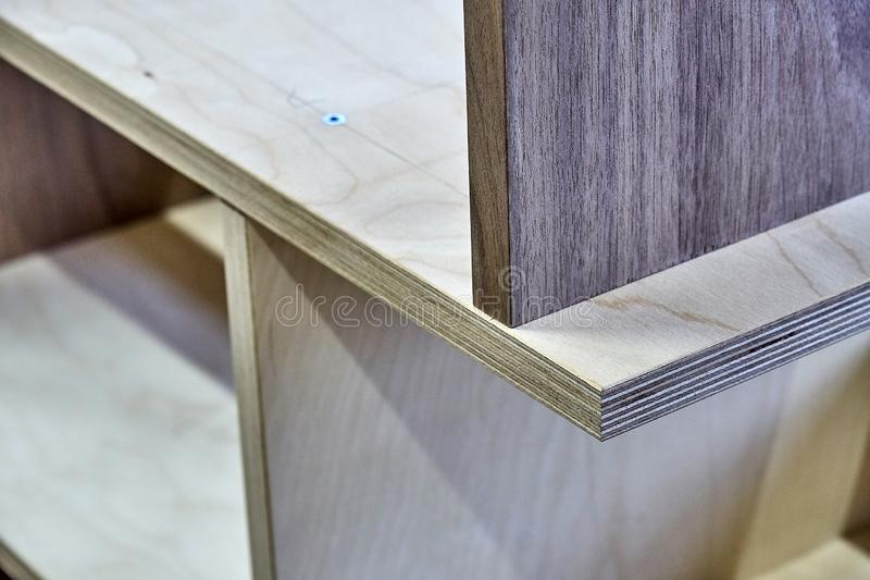 Plywood bookshelves. Production of wood furniture. Furniture manufacture. Close-up. Beautiful professionally made plywood bookshelves in process of production in royalty free stock image