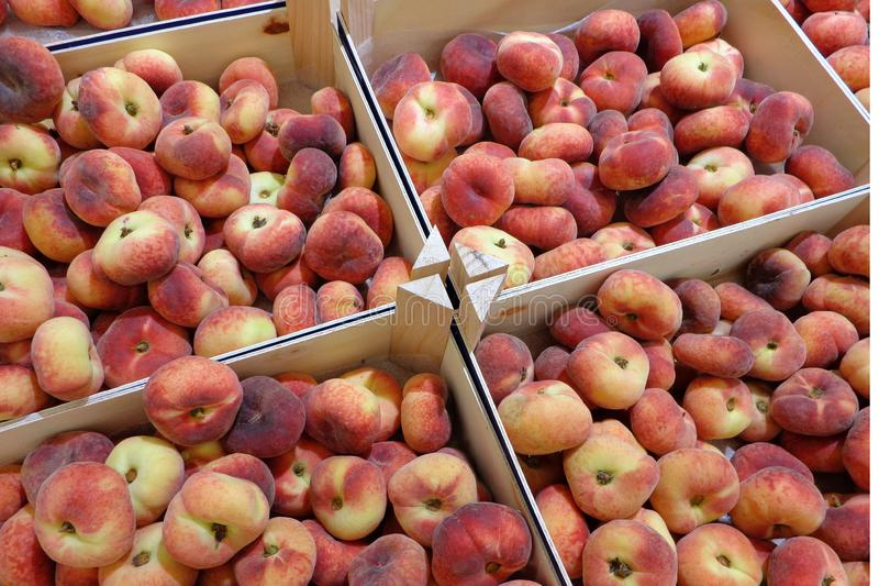 Many boxes with ripe donut peaches at eco supermarket royalty free stock photography