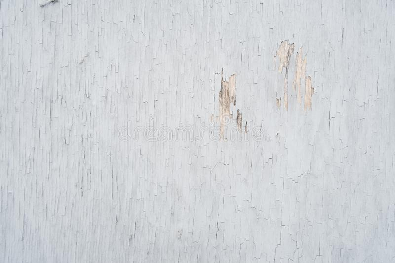 Plywood covered with old peeling paint, for background or texture. stock images