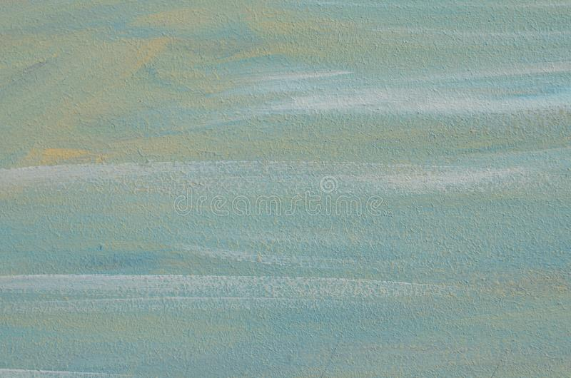 Plywood surface with blue white brush strokes. Plywood surface painted with blue and white light brush strokes. Pastel colored background with fine texture for royalty free stock photos