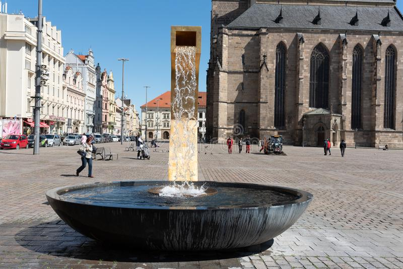 Plzen, Czech Republic, 13/05/2019 fountains in the square of the Cathedral of St. Bartholomew. Famous historical and religious landmark of the city of Plzen stock photography
