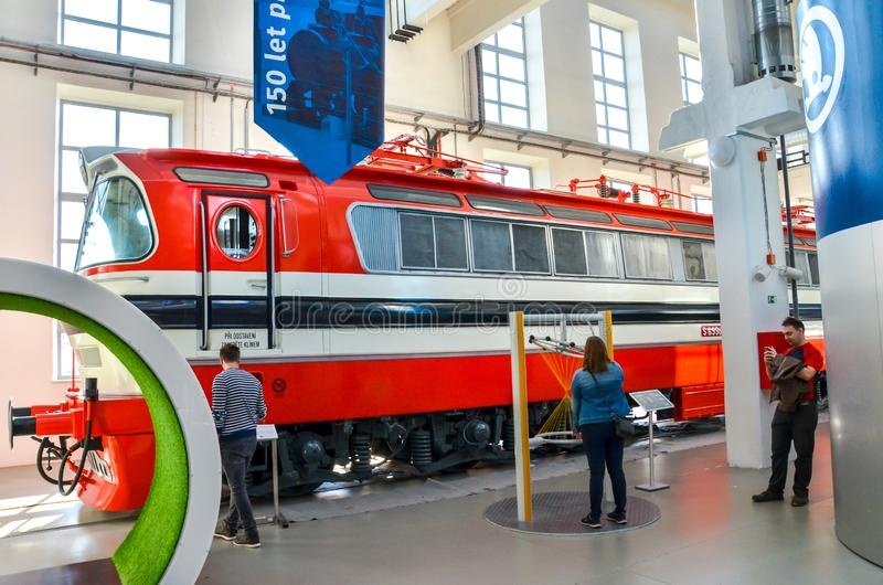 Plzen, Czech Republic - Oct 28, 2019: Inside exhibitions in the Techmania Science Center. Old red train locomotive as one of the. Exhibits. Center explaining royalty free stock photos