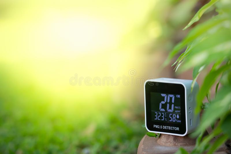 PM 2.5 detector device measuring air pollution stock photo