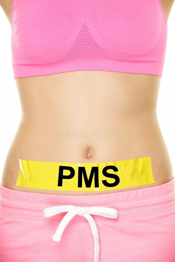 PMS - Fita conceptual no estômago da mulher com texto imagem de stock royalty free
