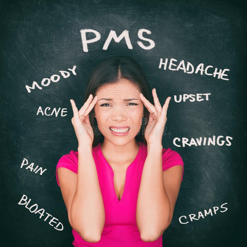 PMS premenstrual syndrome Asian woman holding head in pain having headache, stomach cramps, acne, mood swings with symptoms royalty free stock image