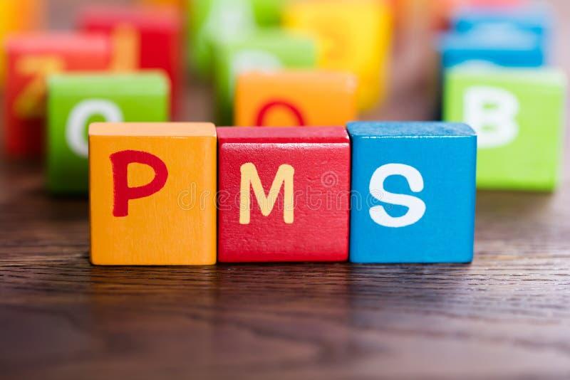 PMS słowo Robić Z blokami zdjęcie royalty free