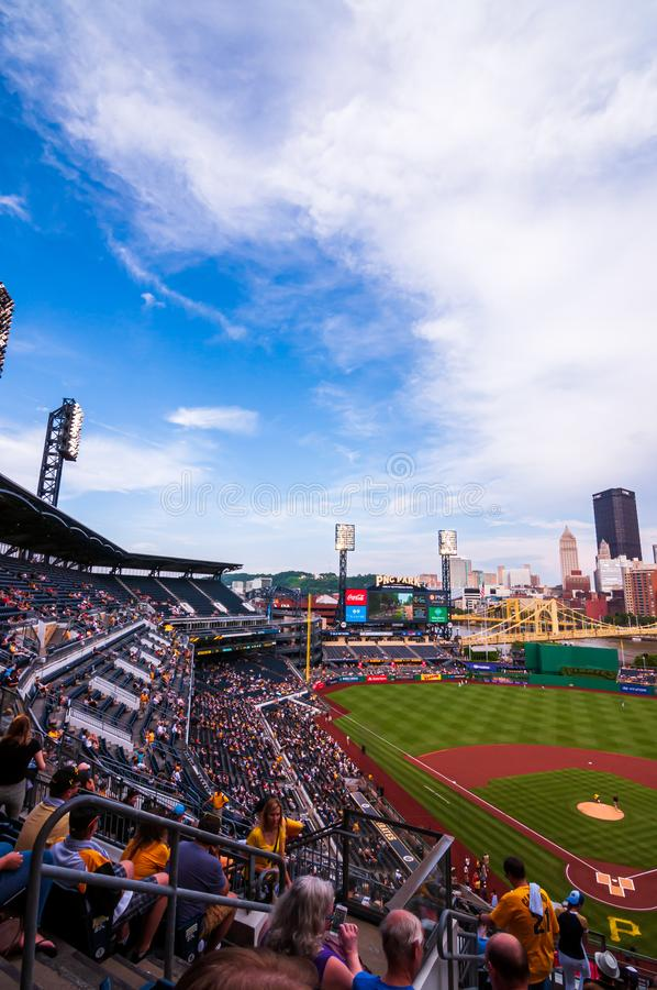 PNC Park, home field to the Pirates playing the Milwaukee Brewers on a summer night looking down the left field line from the seat royalty free stock images