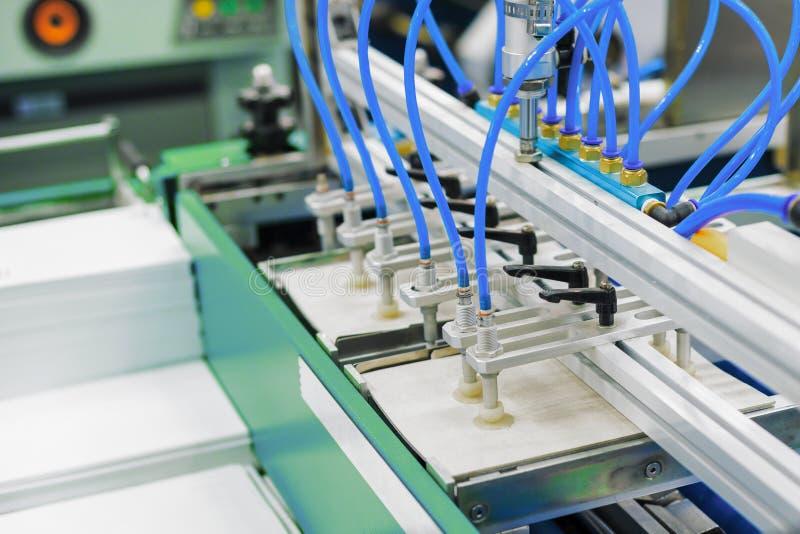 Pneumatic paper feeder. Modern printing machine. Automatic pneumatic sheet baler. Modern printing machine stock image