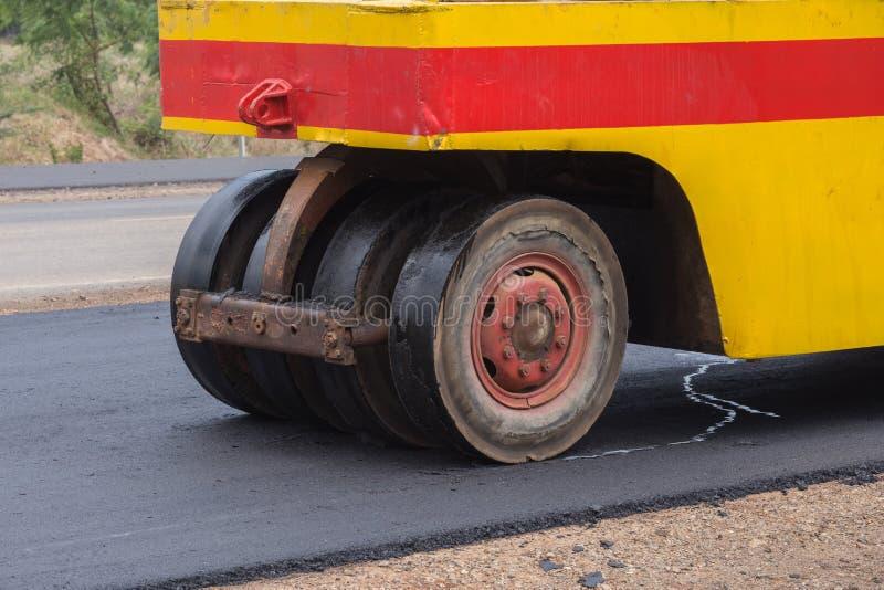 Pneumatic tyred roller compactor at asphalt road. Repairing royalty free stock photo