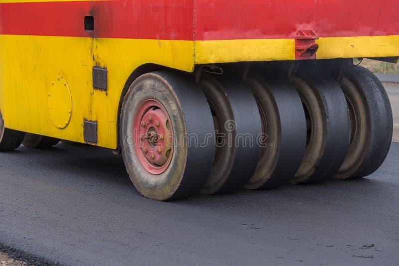 Pneumatic tyred roller compactor at asphalt road. Repairing royalty free stock photos