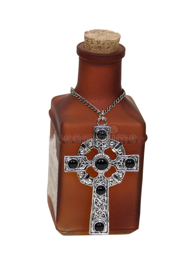 Poção mágica com cruz de prata imagem de stock royalty free