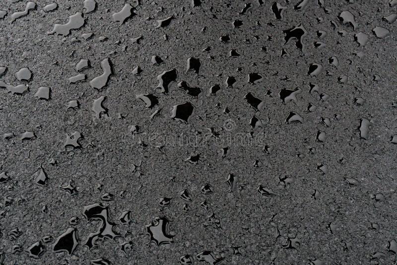 Poças pequenas no asfalto novo limpo foto de stock royalty free