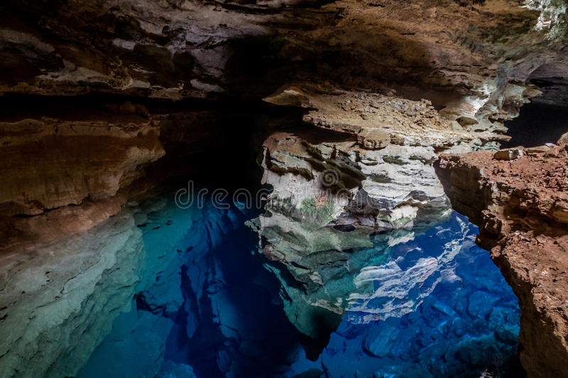 Poço Azul, Cave with blue transparent water in Chapada Diamantina - Bahia, Brazil. Poço Azul, Cave with blue transparent water in Chapada Diamantina in royalty free stock photos