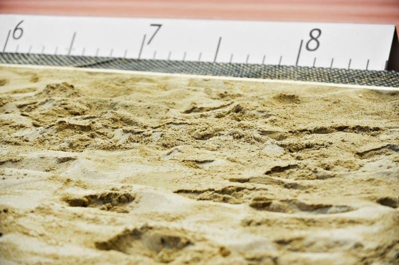 Poço de areia do atletismo foto de stock