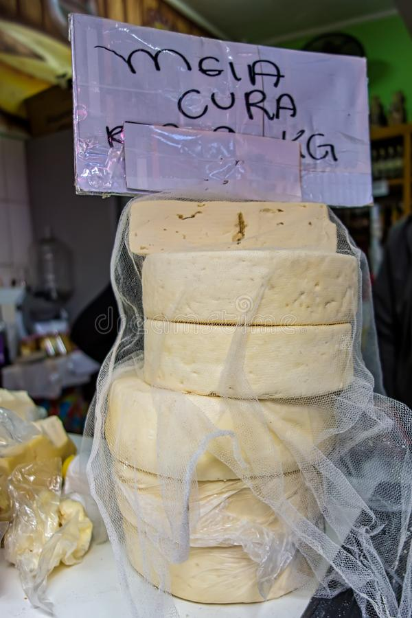 Poços de Caldas, Minas Gerais - Brazil. Handmade cheese, aka Queijo meia-cura, in the city`s popular municipal market. Poços de Caldas, Minas Gerais stock photography