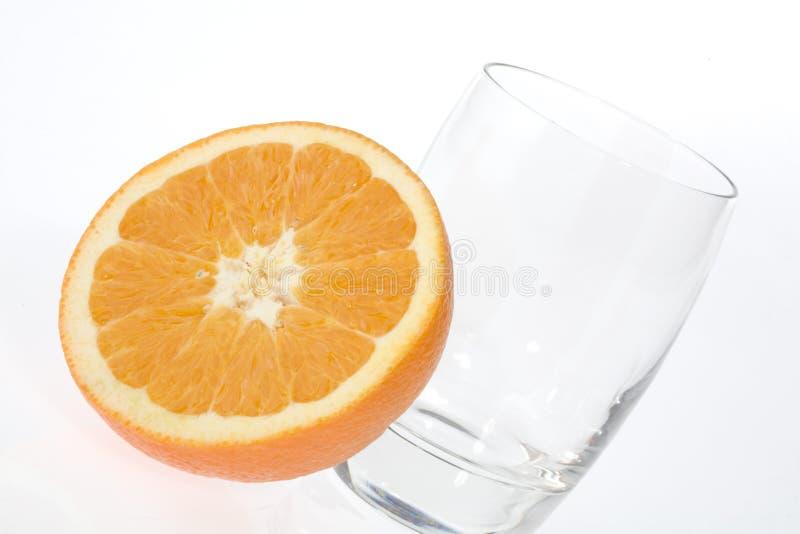 połowa szklana pomarańcze fotografia stock