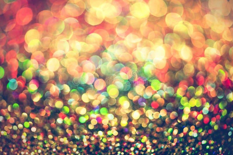 Połyskuje złocistego bokeh Colorfull Zamazującego abstrakcjonistycznego tło dla urodziny, rocznicy, ślubu, nowy rok wigilii lub b zdjęcie royalty free