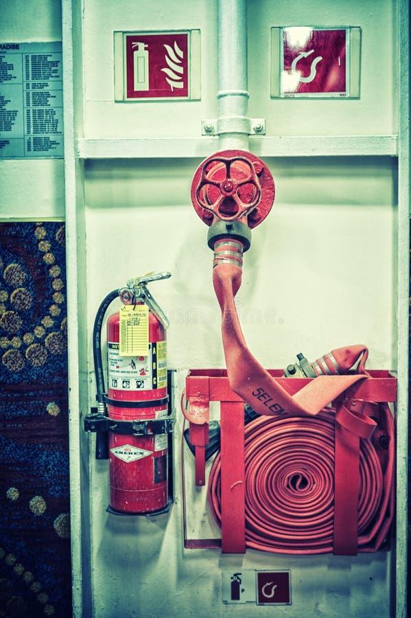 Pożarniczego gasidła i pożarniczego węża elastycznego rolka obraz stock