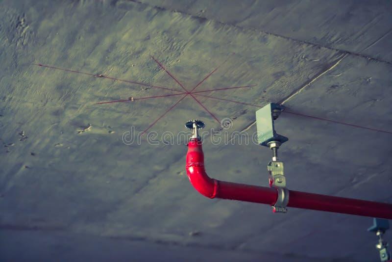 Pożarniczy kropidło i czerwieni drymba (Filtrujący wizerunek przetwarzający rocznik obrazy stock