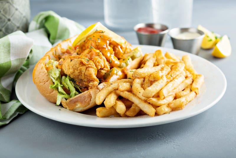 Po boy sandwich with fried shrimp. And fries stock photo
