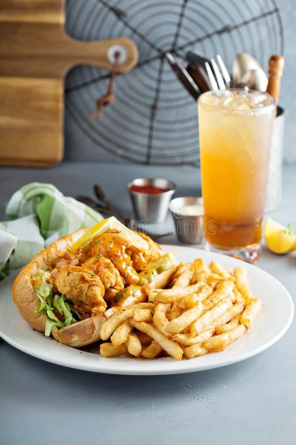 Po boy sandwich with fried shrimp. And fries royalty free stock photos
