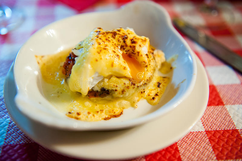 Poached egg dish. In a dish on a red table cloth royalty free stock photography
