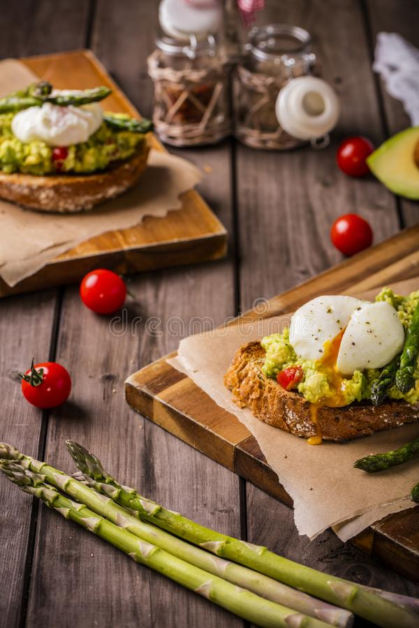 Poached eggs rustic portrait royalty free stock photo
