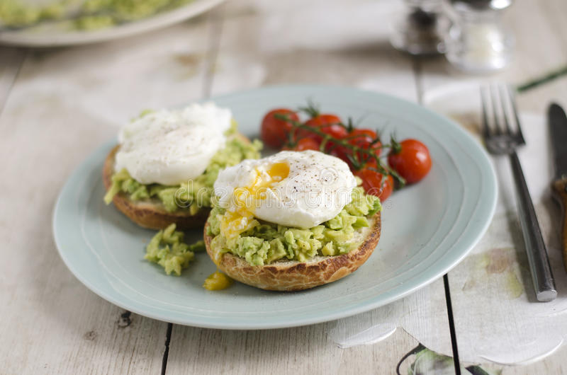Poached eggs and avocado on toast stock images