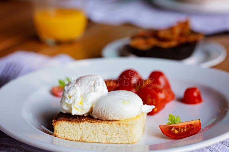 Poached eggs for breakfast royalty free stock image