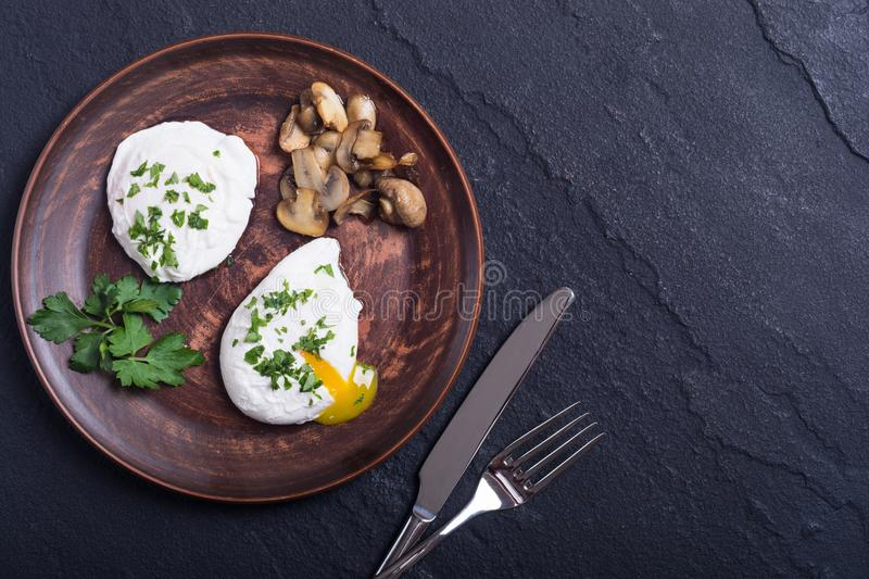 Poached eggs with parsley and mushrooms royalty free stock images