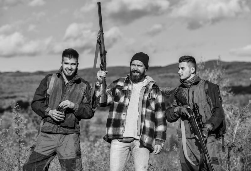 Poacher partner in crime. Activity for real men concept. Hunters gamekeepers looking for animal or bird. Hunters with stock photo