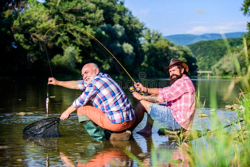 Poaching crime and fishing license. Black market caviar. Poachers fishing. Trap for fish. Men sit at riverside with royalty free stock photos