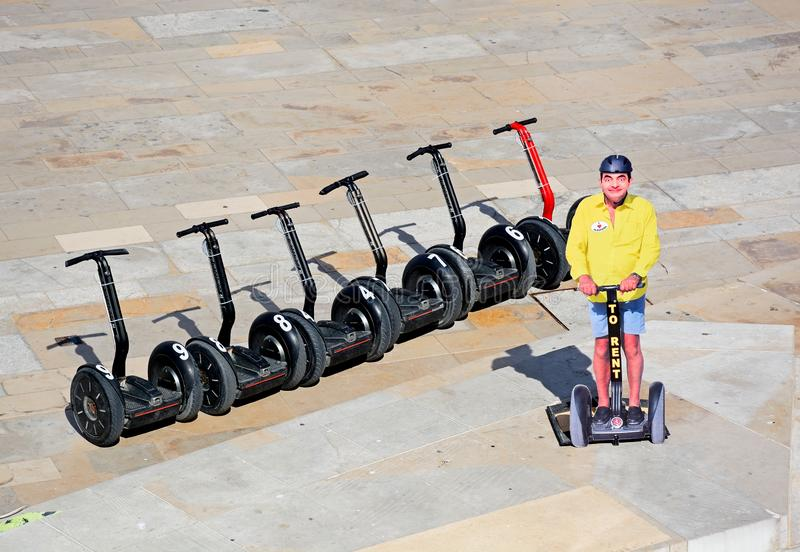 Row of Segways for hire, Albufeira. Row of Segways for hire in the square along Largo 35 de Abril, Albufeira, Algarve, Portugal, Europe stock photography
