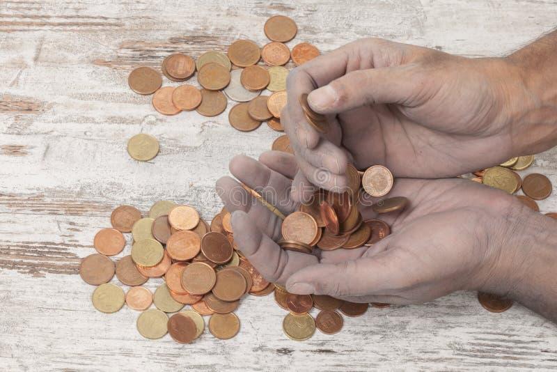 Pobres y monedas imagen de archivo libre de regalías